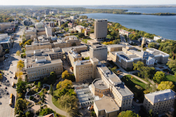 The central University of Wisconsin-Madison campus is pictured in an aerial view during autumn on Oct. 12, 2013. Clockwise from the bottom left, major campus facilities include the Botany Gardens, Chamberlin Hall, Sterling Hall, Medical Sciences Center, Van Hise Hall, Bascom Hall, Van Vleck Hall and Birge Hall. In the background at right are Lake Mendota and Picnic Point. The photograph was made from a helicopter looking west. (Photo by Jeff Miller/UW-Madison)