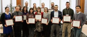 Winners of campus-wide TA awards pose with certificates
